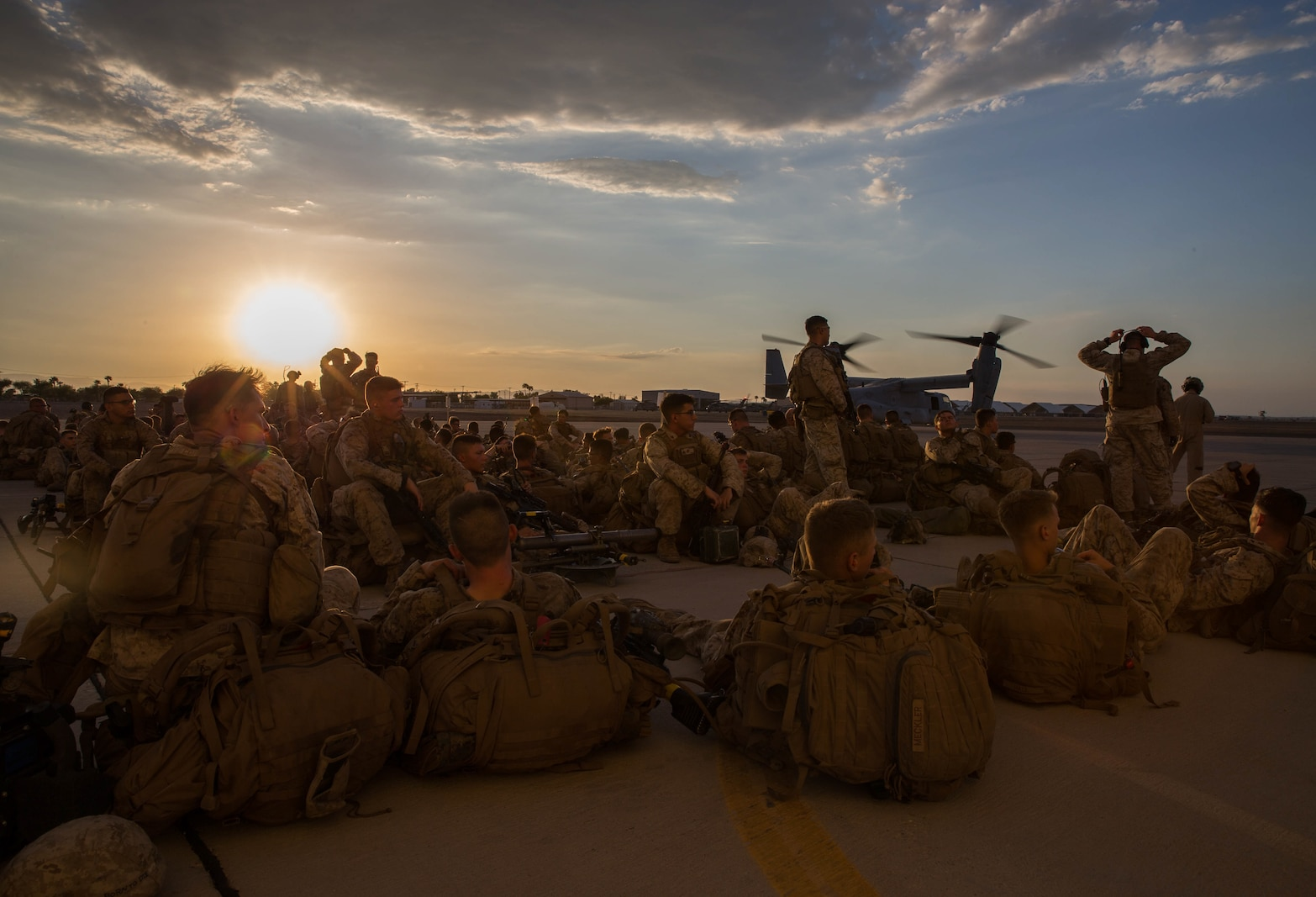 U.S. Marines with 2nd Battalion, 4th Marines, wait to board the MV-22 Osprey during Summer Fury at Naval Air Facility El Centro, Calif., Aug. 4, 2017.