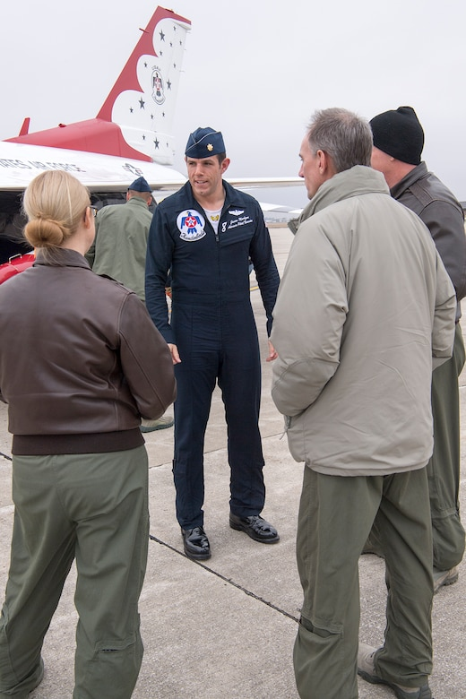 Maj. Jason Markzon, pilot of Thunderbird 8, talks with Grissom members upon his landing at Grissom Air Reserve Base, Ind., Feb. 5, 2019. Markzon visited the base in preparation for the Grissom Air and Space Expo scheduled for Sept. 7-8, 2019. (U.S. Air Force photo/Douglas Hays)