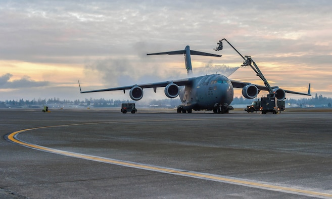 Airmen assigned to the 62nd Aircraft Maintenance Squadron spray a C-17 Globemaster III with deicing liquid at Joint Base Lewis-McChord, Wash., Jan. 16, 2019. Ice and snow on the flight control surfaces, such as the tail and wings, can introduce unknown aerodynamic characteristics that may render the aircraft unsafe for takeoff. (U.S. Air Force photo by Senior Airman Tryphena Mayhugh)