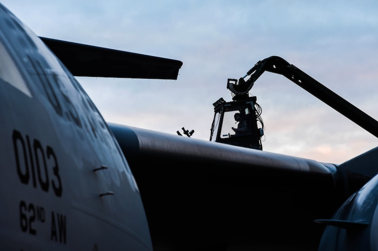 Senior Airman Dakota Crites, 62nd Aircraft Maintenance Squadron integrated flight control systems specialist, prepares to spray a C-17 Globemaster III with deicing liquid at Joint Base Lewis-McChord, Wash., Jan. 16, 2019. Crites and other 62nd AMXS Airmen deice aircraft throughout the winter months to ensure jets are safe to fly. (U.S. Air Force photo by Senior Airman Tryphena Mayhugh)