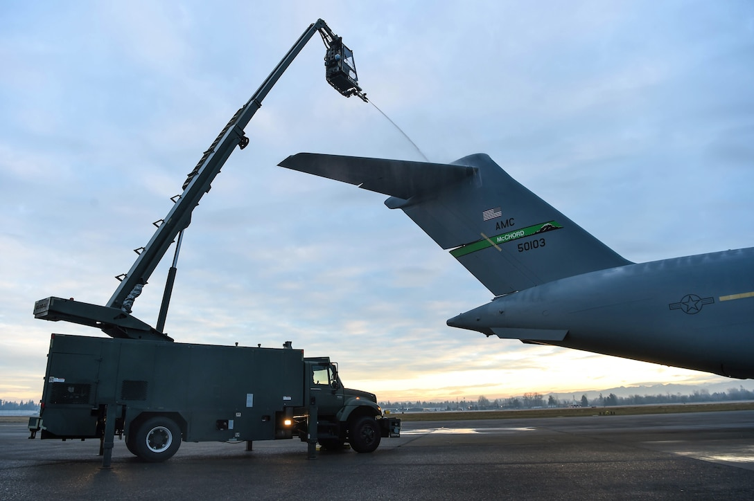 Senior Airman Dakota Crites, 62nd Aircraft Maintenance Squadron integrated flight control systems specialist, sprays the tail of a C-17 Globemaster III with deicing liquid at Joint Base Lewis-McChord, Wash., Jan. 16, 2019. When needed, an aircraft must be deiced four hours before take-off when the weather reaches freezing temperatures in order to be safe to fly. (U.S. Air Force photo by Senior Airman Tryphena Mayhugh)