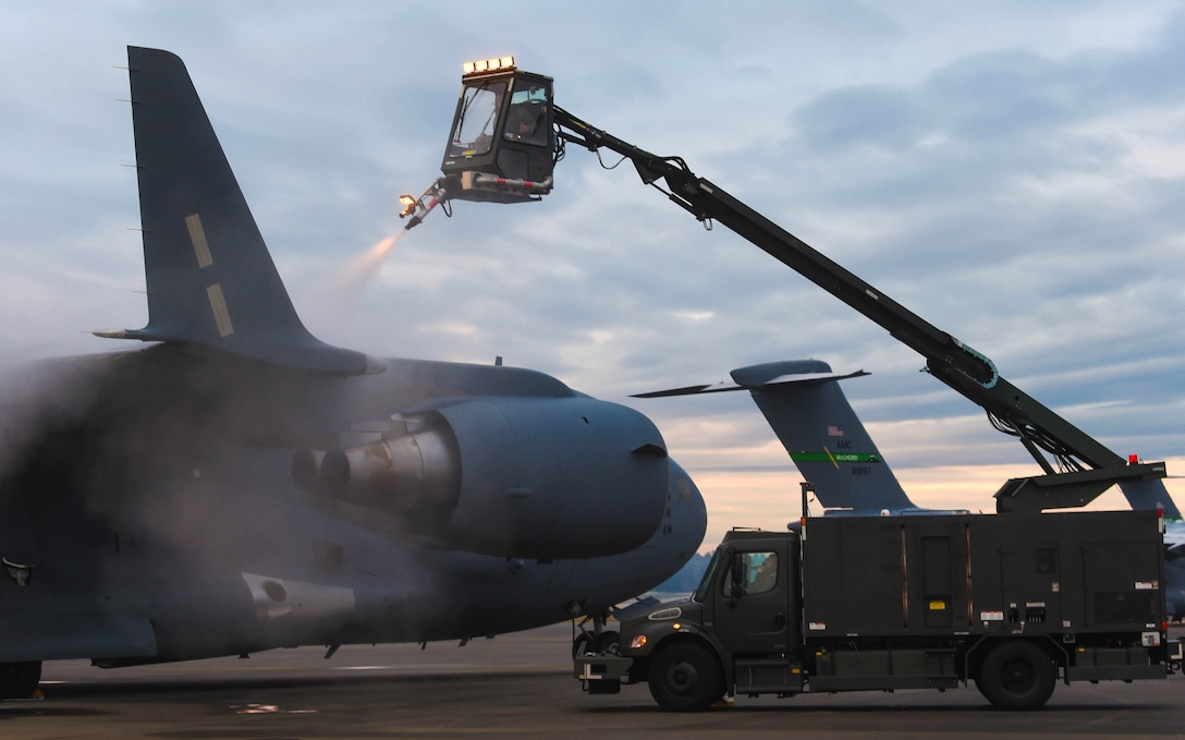 In order to make the aircraft safe to fly, Tech. Sgt. Salomon Gutierrez, 62nd Aircraft Maintenance Squadron noncommissioned officer in charge of Silver Flight, sprays a C-17 Globemaster III's wing with deicing liquid at Joint Base Lewis-McChord, Wash., Jan. 16, 2019. Gutierrez and other 62nd AMXS Airmen deiced the wings and tail of the aircraft to make it safe to fly. (U.S. Air Force photo by Senior Airman Tryphena Mayhugh)