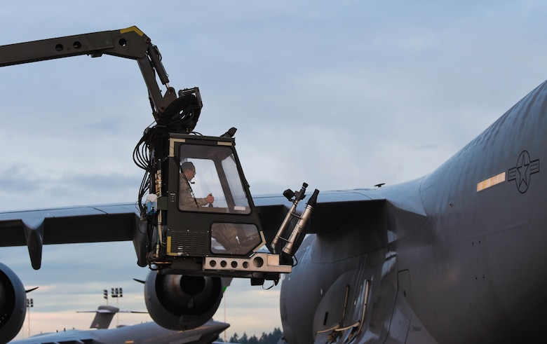 Senior Airman Dakota Crites, 62nd Aircraft Maintenance integrated flight control systems specialist, brings the bucket of a deicing truck down to the ground after deicing a C-17 Globemaster III at Joint Base Lewis-McChord, Wash., Jan. 16, 2019. Crites and other 62nd AMXS Airmen sprayed deicing liquid on the wings and tail of the C-17 to remove snow and ice from the aircraft and make it safe to fly. (U.S. Air Force photo by Senior Airman Tryphena Mayhugh)