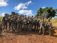 U.S. Marines Lt. Col. Warren C. Cook, Commanding Officer and SgtMaj Jose H. Molina, Sergeant Major for 2nd Battalion 4th Marines take a photo with Weapons Platoon while visiting Company F at Shoal Water Bay Training Area during Diamond Strike on May 30, 2018.