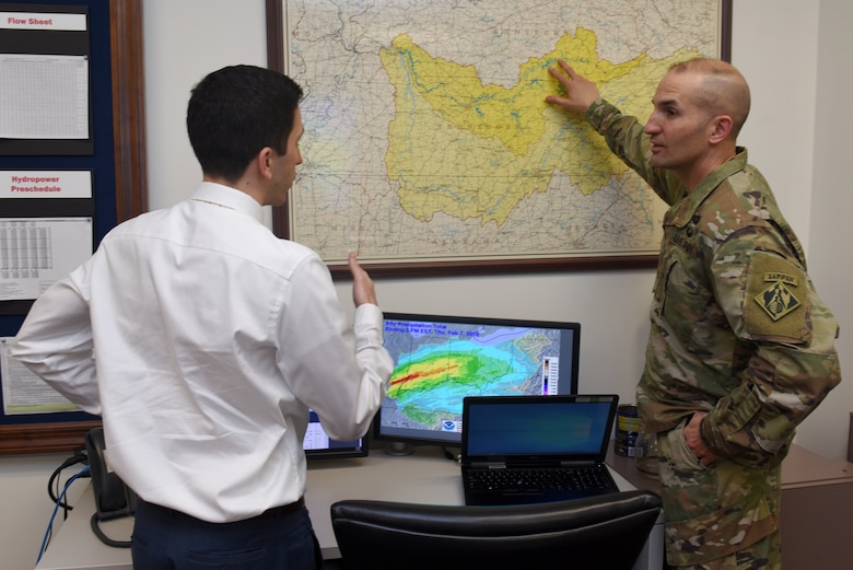 Col. Paul J. Kremer (Right), U.S. Army Corps of Engineers Great Lakes and Ohio River Division deputy commander, interacts with Anthony Rodino, Nashville District Water Management Section chief, during a water management update Feb. 7, 2018 at the district headquarters. (USACE photo by Lee Roberts)