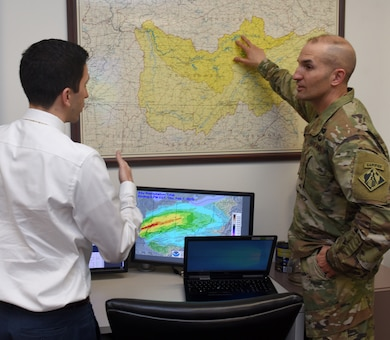 Col. Paul J. Kremer (Right), U.S. Army Corps of Engineers Great Lakes and Ohio River Division deputy commander, interacts with Anthony Rodino, Nashville District Water Management Section chief, during a water management update Feb. 7, 2018 at the district headquarters in Nashville, Tenn. (USACE Photo by Lee Roberts)