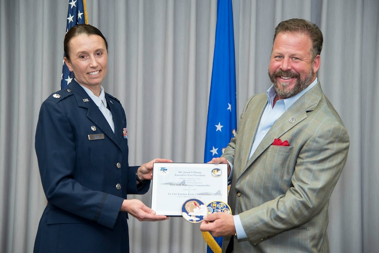 39th Flying Training Squadron Commander Lt. Col. Kristen Kent presents the induction certificate to the squadron's new honorary commander, Gillman Companies Executive Vice President Jason Gillman, during the Feb. 1 honorary commander induction ceremony held at Joint Base San Antonio-Randolph, Texas. (U.S. Air Force photo by Sean Worrell)