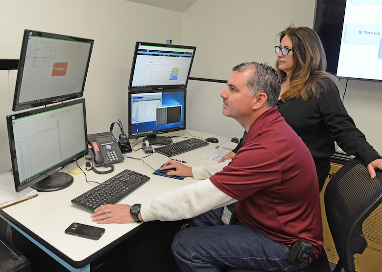Fernando Sanchez and Minta Huddleston, 412th Civil Engineer Squadron, work in the new Industrial Control Systems Innovation Lab Feb. 7. The ICS Innovation Lab will be used primarily by field service technicians to research, develop, test and evaluate new and existing controls on Heating, Ventilation and Air Conditioning Equipment, water distribution, emergency power, sewage and more. (U.S. Air Force photo by Kenji Thuloweit)