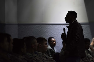 Retired Chief Master Sgt. Anthony Brinkley speaks to service members at Yokota Air Base, Japan February 8, 2019 in the base theater. Brinkley served 28 years in the Air Force, 12 as a first sergeant, before retiring and pursuing a life as a motivational speaker. (U.S. Air Force  photo by Staff Sgt. Kyle Johnson)