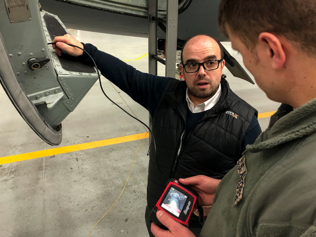 "Snap-on Industrial representative Matt Elliston shows Staff Sgt. Tommy James, 100th Maintenance Squadron propulsion systems craftsman, a digital inspection kit during a technology demonstration at RAF Mildenhall, England, Jan. 31, 2019. The 100th MXS is seeking funds to purchase the kit, as well as a ""smart toolbox"" to free up more time to work on their aircraft. (U.S. Air Force photo by Senior Airmen Kelly O'Connor)"