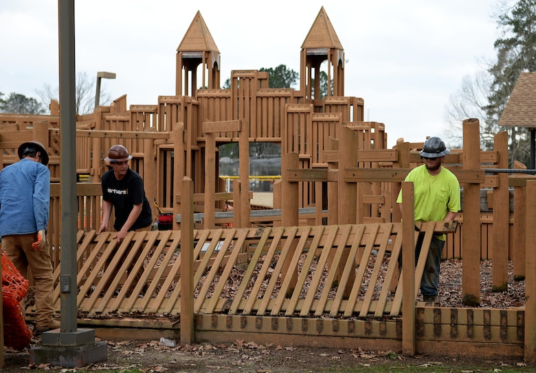 Construction workers disassemble pieces of Freedom Park during demolition Feb. 6, 2019, on Columbus Air force Base, Mississippi. The Freedom Park playground was built in 1996, a time when playgrounds were typically constructed with wooden materials. (U.S. Air Force photo by Airman Hannah Bean)