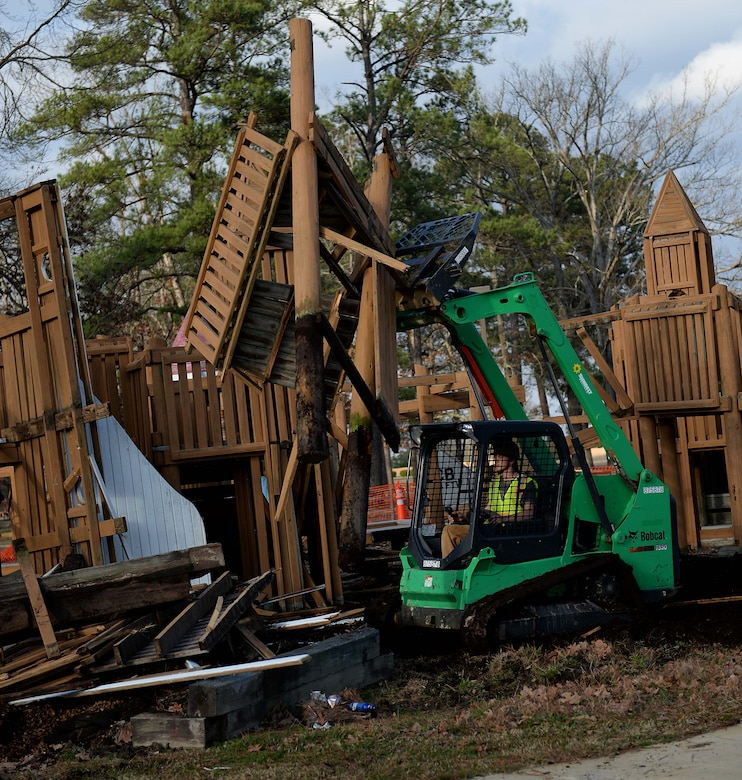 A Bobcat T550 Compact Track Loader carries pieces of Freedom Park to a pile during demolition Feb. 6, 2019, on Columbus Air force Base, Mississippi. Since its construction over 20 years ago, several areas of Freedom Park have deteriorated, creating an ever-increasing safety hazard. (U.S. Air Force photo by Airman Hannah Bean)