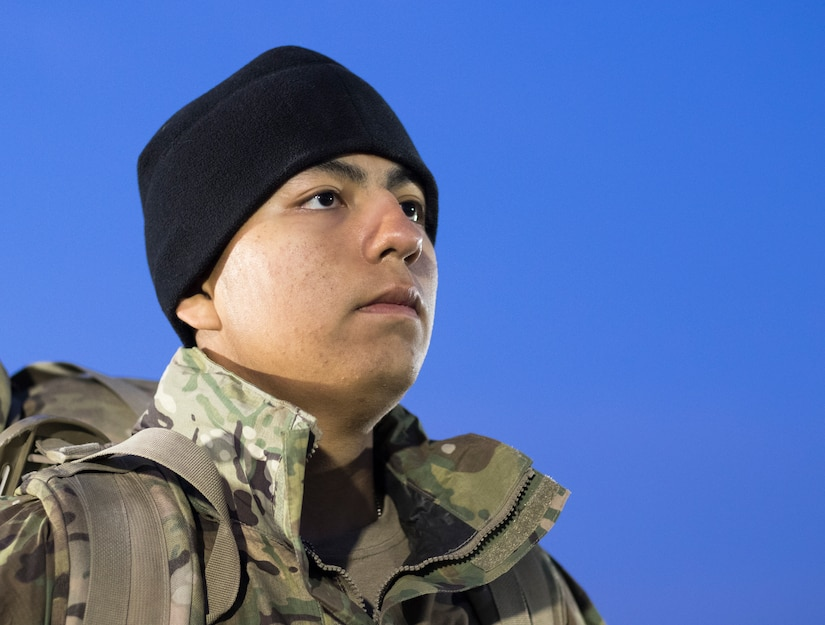 United States Army Pfc. Alberto Garcia, assigned to 20th Engineer Brigade, stands at attention after a 6-mile ruck march during day two of Air Assault School's Class 301-19 on Feb. 7, 2019, at Camp Buehring, Kuwait. Developing a prepared and capable leader is one of the U.S. Army's modernization efforts.