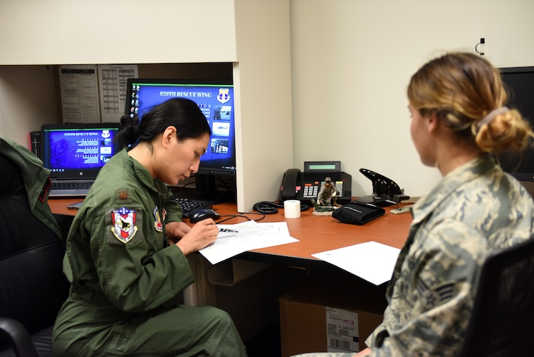 Maj. Tina Nguyen, a Flight Surgeon assigned to the 104th Fighter Wing, Barnes Air National Guard, gives a physiology brief to Senior Airman Hope Geiger, a photojournalist assigned to the 180th Fighter Wing, Ohio Air National Guard, during an incentive flight physical. As part of the Patrick AFB deployment, the 180FW will conduct Dissimilar Air Combat Training, Basic Fighter Maneuvers, Defensive Air Counter Tactics and Tactical Intercept missions alongside F-15 Eagles assigned to the 104th Fighter Wing, Barnes Air National Guard Base, Massachusetts.  Incentive flights are special flights provided to outstanding Airmen who continually go above and beyond in their primary duties. (Air National Guard photo by Senior Master Sgt. Beth Holliker)