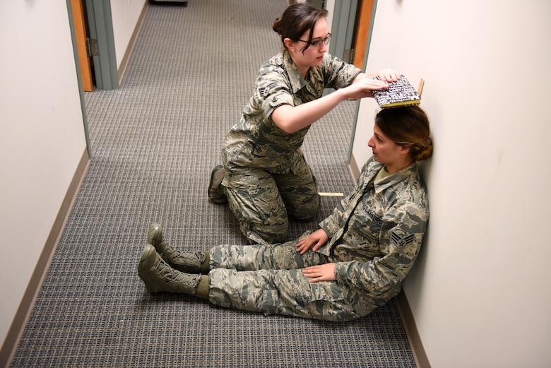 Senior Airman Kathryn Dobbs, an aerospace medical technician assigned to the 180th Fighter Wing, Ohio Air National Guard, checks the sitting height of Senior Airman Hope Geiger, a photojournalist also assigned to the 180FW, during an incentive flight physical at Patrick Air Force Base, Florida, Feb. 1, 2019. The 180FW deployed more than 130 Airmen and 10 F-16s to Patrick in an effort to enhance flying operations and readiness capabilities that can often be hindered by harsh winter weather at home-station in Northwest Ohio. Incentive flights are special flights provided to outstanding Airmen who continually go above and beyond in their primary duties. (Air National Guard photo by Senior Master Sgt. Beth Holliker)