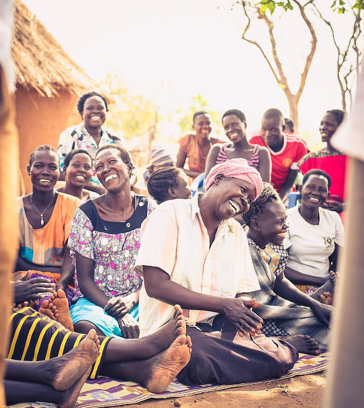 Refugees from Tutapona smiling and laughing