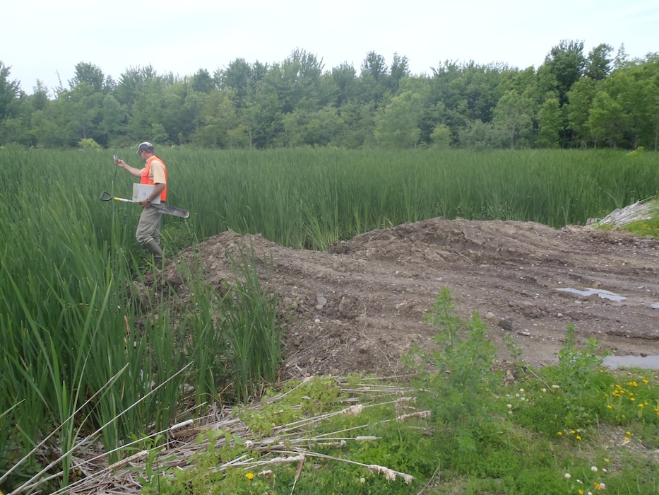 A Buffalo District Project Manager collects data to determine if fill material is located within a wetland area in response to a complaint.