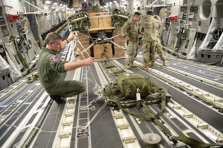 Loadmaster preparing extraction chute