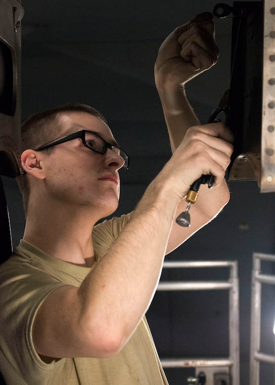 Airman 1st Class Connor Karman, an aerospace propulsion technician with the 445th Maintenance Squadron, performs routine maintenance on the wing of a C-17 Globemaster III. (U.S. Air Force photo/Senior Airman Ethan Spickler)