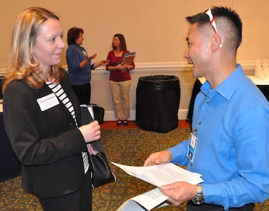 "IMAGE: FREDERICKSBURG, Va. (Feb. 5, 2019) - A Naval Surface Warfare Center Dahlgren Division (NSWCDD) representative discusses career opportunities with a candidate at the NSWCDD Career Fair. The command made 36 on-the-spot job offers at the event held in the Fredericksburg Expo and Conference Center. ""This is the first year that we opened the event up to non-science and engineering positions and we had an overwhelming response for our contract, financial, and information technology positions,"" said Shelby Khan, the NSWCDD Human Resources Recruiting Program lead. ""We anticipate additional interviews and offers resulting from the career fair in the weeks to come."""