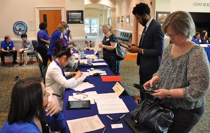 IMAGE: FREDERICKSBURG, Va. (Feb. 5, 2019) - Job candidates check in with Naval Surface Warfare Center Dahlgren Division (NSWCDD) representatives at the command's Career Fair. NSWCDD made 36 on-the-spot job offers at the event held in the Fredericksburg Expo and Conference Center. In all, 313 candidates with bachelor's, master's, and doctoral degrees in technical and business fields inquired about positions available for entry-level and experienced scientists, engineers, and business professionals.
