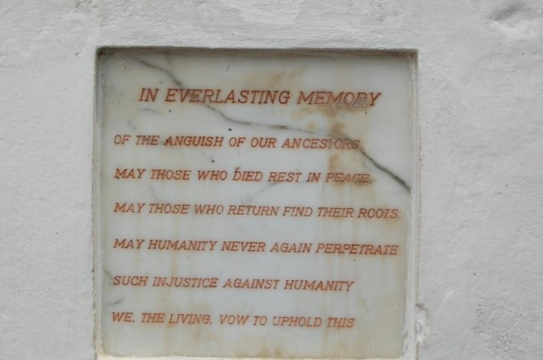 Ghana's pledge to never again perpetrate the injustice of slavery from their Coasts engraved at one of the Cape Coast castles that housed the slaves prior to their transatlantic trip. (Courtesy photo/Breanna McGowan)
