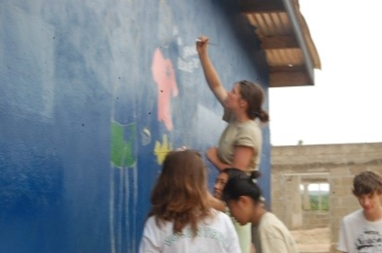 Teen volunteers painting the orphanage. (Courtesy photo/Breanna McGowan)