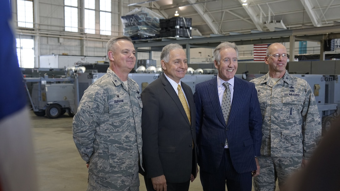 Group shot of 439th Airlift Wing Commander D. Scott Durham, Chicopee Mayor Richard Kos, U.S. Congressman Richard Neal, and 439th Maintenance Group Commander Col. David Post in Hangar 9, one of Westover's 80-year-old hangars.