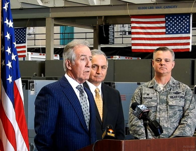 U.S. Congressman Richard Neal speaks at the podium in Hangar 9.