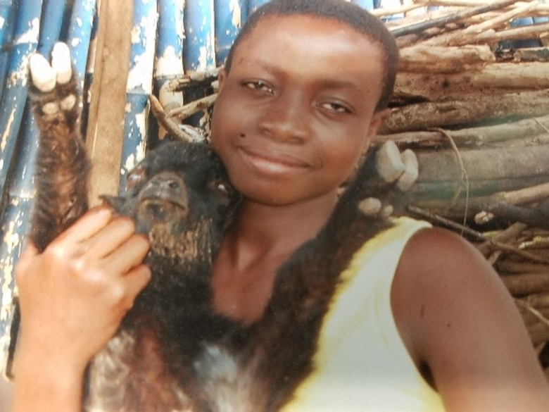 A teenage girl at an orphanage on the Cape Coast, Ghana, holding ababy goat. (Courtesy photo/Breanna McGowan)