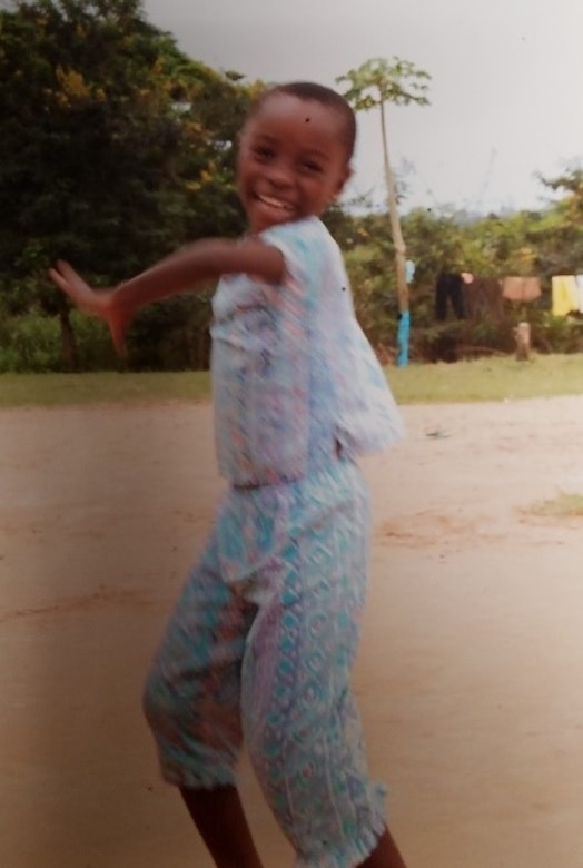 A Ghanaian orphan girl twirling at the orphanage. (Courtesy photo/Breanna McGowan)