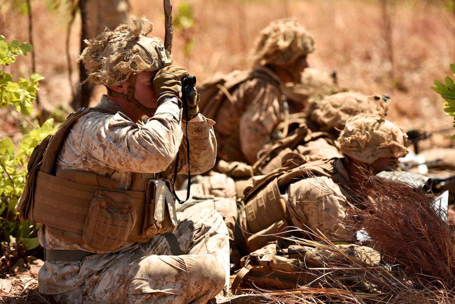 Capt. Benjamin J. O'Donnell, infantry officer with 2nd Battalion, 4th Marine Regiment, 1st Marine Division, views the targets while providing indirect fire support from M777 artillery, 81mm mortars and close air support during training Aug. 10, 2018, at Mount Bundey Training Area, Northern Territory, Australia.