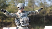 A Basic Officer Leader Course student tosses a simulated grenade during field training at the Fort Lee range complex in November. A project is well underway to lay out an area at the range that will enhance this type of training. It's another example of CASCOM's efforts to fully develop initial entry training Soldiers so they're ready for the operational Army.