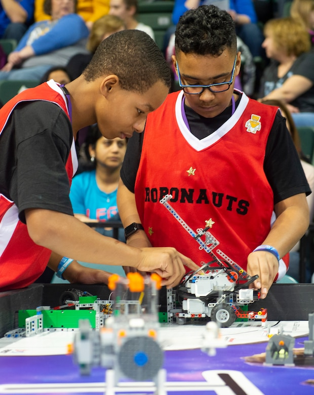 Charles Doxley (left) and Jacob Goings work with their robot during the FIRST LEGO League Ohio championship tournament Feb. 3 in Wright State University's Ervin J. Nutter Center.