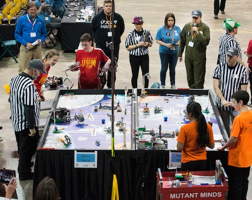 Two teams put their robots through their paces in the second round of the FIRST LEGO League Ohio championship tournament Feb. 3 in Wright State University's Ervin J. Nutter Center.