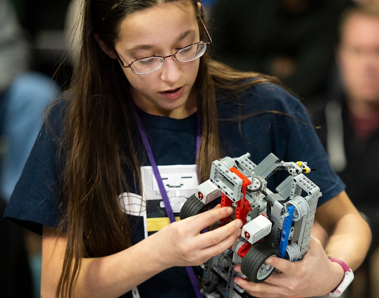 Tabitha Blankenship, 13, works on the Buzz, Buzz, Sting Sting team robot during the FIRST LEGO League Ohio championship tournament.