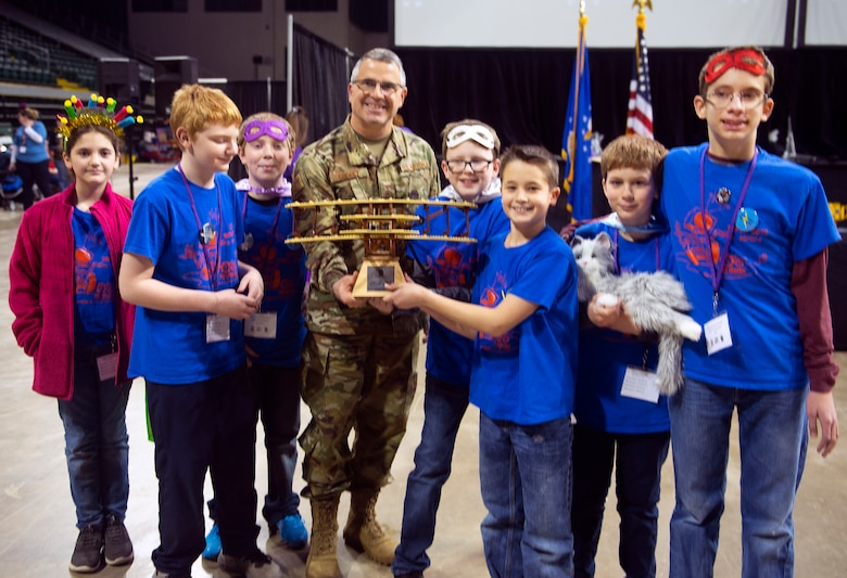 Maj. Gen. William T. Cooley, Air Force Research Laboratory commander, presents the Wright-Patterson Air Force Base Founder's Award to the LV Super Bots at the FIRST LEGO League Tournament in the Wright State University Nutter Center Feb. 3.