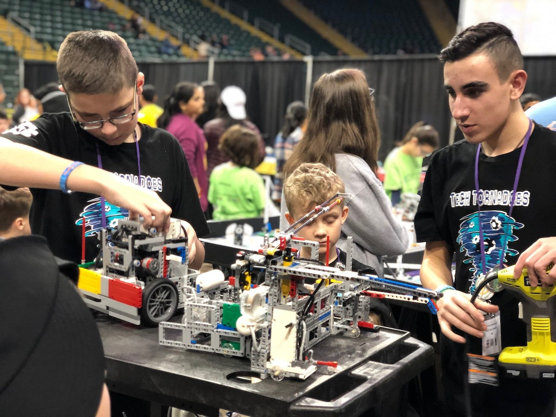 Team Tech Tornadoes work on their robot at the FIRST LEGO League Ohio championship tournament Feb. 3.