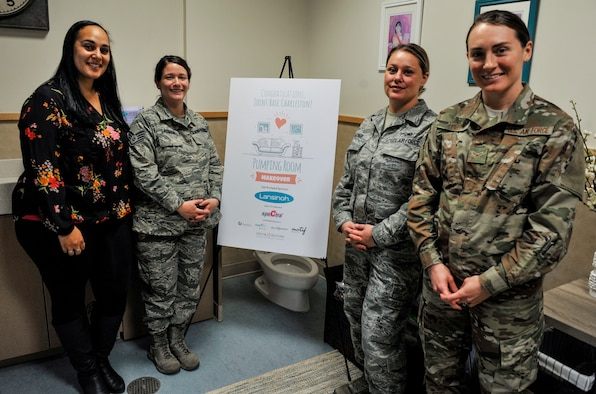 Mamie Futrell, 628th Air Base Wing sexual assault response coordinator for the Air Base, stands with military members to highlight the opening of the new pumping room Jan. 11, 2019, in the Child Development Center at Joint Base Charleston – Air Base.