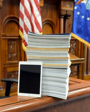 A tablet leans on a stack of legal documents Feb. 8, 2019, on Offutt Air Force Base, Neb. The 55th Wing Judge Advocate office recently purchased to tablets in order to reduce time, man-hours and paper waste. (U.S. Air Force photo by Kendra Williams)