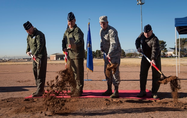 Gen. Mike Holmes, commander of Air Combat Command, Maj. Gen. Peter Gersten, U.S. Air Force Warfare Center commander, Brig. Gen. William Burks, the Adjutant General for the state of Nevada, and Col. Christopher Zuhlke, Nevada Test and Training Range commander, break ground on the Virtual Test and Training Center (VTTC) on Nellis Air Force Base, Nevada, Jan. 8, 2019. VTTC training will allow warfighters to adapt to the future fight, while strengthening security on the home front. (U.S. Air Force photo by Airman 1st Class Bailee A. Darbasie)