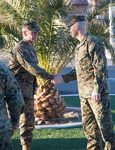 Brigadier General Jospeh Shrader, Commanding General, Marine Corps Logistics Command, is greeted by Colonel Craig Clemans, Commander, Marine Corps Logistics Base Barstow, prior to the general's scheduled Town Hall meeting with Production Plant Barstow personnel, Feb. 6.