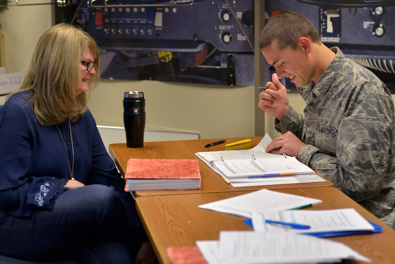 Katherine Chowdhary, 334th Training Squadron instructor, assists Airman Andrew Ebert, 334th TRS air traffic control student, with an assignment at Keesler Air Force Base, Mississippi, Feb. 2, 2019. Chowdhary's class is the first to incorporate an Active Learning Environment in the ATC course and throughout the course she ensures her students are given the opportunity to understand the course material fully. The 81st Training Group encourages all instructors to implement innovative techniques to better develop Mach-21 Airmen. (U.S. Air Force photo by Airman 1st Class Kimberly L. Mueller)