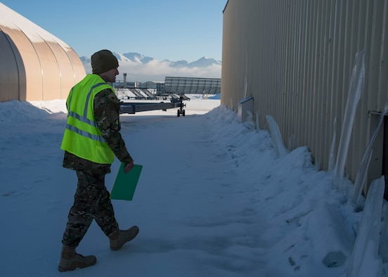U.S. Air Force Master Sgt. David Ballew, 673d CES project manager, performs a post-earthquake inspection of a facility at Joint Base Elmendorf-Richardson, Alaska, Jan. 31, 2019. Since the Nov. 30, 2018 earthquake more than 20 CES Airmen have been trained in the ATC-20-1 Post-earthquake Safety Evaluation of Buildings to maintain and improve agile support capabilities.