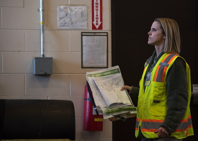 U.S. Air Force Staff Sgt. Courtney Kohnke, 673d Civil Engineer Squadron construction inspector, performs a post-earthquake inspection of a level-four rated facility at Joint Base Elmendorf-Richardson, Alaska, Jan. 31, 2019. Since the Nov. 30, 2018 earthquake more than 20 CES Airmen have been trained in the ATC-20-1 Post-earthquake Safety Evaluation of Buildings to maintain and improve agile support capabilities.
