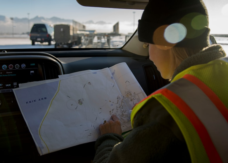 U.S. Air Force Staff Sgt. Courtney Kohnke, 673d Civil Engineer Squadron construction inspector, looks at a map of facilities at Joint Base Elmendorf-Richardson, Alaska, Jan. 31, 2019. Since the Nov. 30, 2018 earthquake more than 20 CES Airmen have been trained in the ATC-20-1 Post-earthquake Safety Evaluation of Buildings to maintain and improve agile support capabilities. A level-four category is for facilities used seasonally or infrequently.