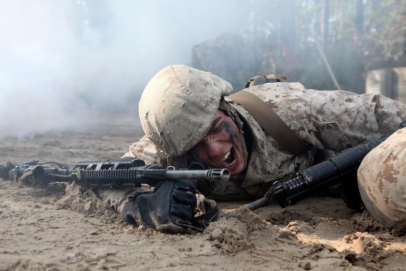 Marine crawls through sand