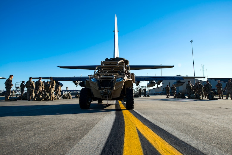 Airmen from the 823d Base Defense Squadron (BDS) prepare to board an HC-130J Combat King II during airfield security training, Jan. 28, 2019, at Moody Air Force Base, Ga. The training was geared toward bolstering the 823d BDS's adaptive base readiness, which consisted of improving Airmen's capabilities to effectively and efficiently on-load equipment along with more than 30 fully-equipped personnel into an aircraft, followed by establishing airfield security. (U.S. Air Force photo by Airman 1st Class Erick Requadt)