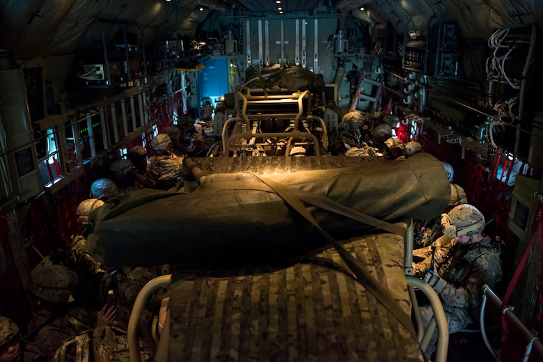 Airmen from the 823d Base Defense Squadron (BDS) fit into an HC-130J Combat King II during airfield security training, Jan. 28, 2018, at Moody Air Force Base, Ga. The training was geared toward bolstering the 823d BDS's adaptive base readiness, which consisted of improving Airmen's capabilities to effectively and efficiently on-load equipment along with more than 30 fully-equipped personnel into an aircraft, followed by establishing airfield security. (U.S. Air Force photo by Airman 1st Class Erick Requadt)
