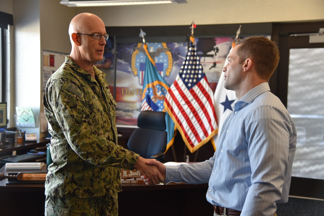 Distribution acquisition specialist honored with commander coin